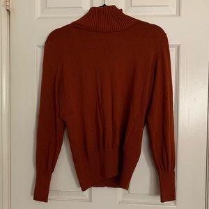 Rust orange turtleneck sweater